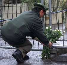 German policeman placing flowers in memory
