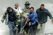 Firefighters remove the body of Rev. Mike